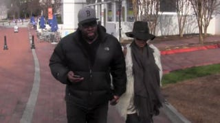 Bobby Brown and his wife, Alicia Etheredge, arrive at Emory University Hospital in Atlanta on Wednesday. TMZ screenshot