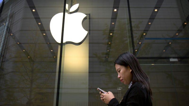 A woman walks past an Apple store in Beijing in 2017.