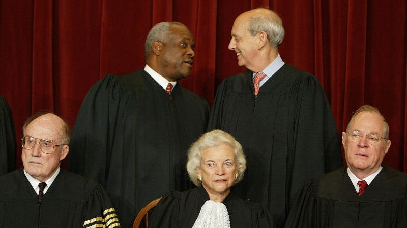 US Supreme Court Justices (L-R, Seated) Chief Justice William H. Rehnquist, Associate Justice Sandra Day O'Connor, Associate Justice, Anthony M. Kennedy, (L-R, Standing) Associate Justice Clarence Thomas and Stephen G. Breyer pose for pictures at the US Supreme Court December 5, 2003 in Washington, DC.
