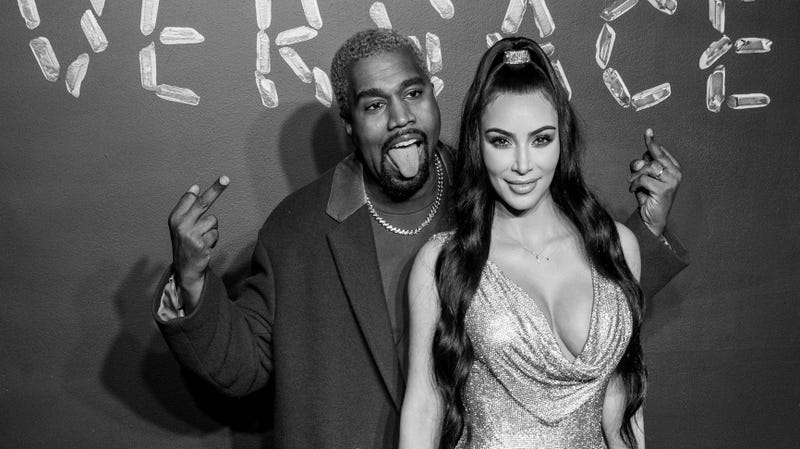 (Image has been converted to black and white.) Kanye West and Kim Kardashian West attend the the Versace fall 2019 fashion show at the American Stock Exchange Building in lower Manhattan on December 02, 2018 in New York City.