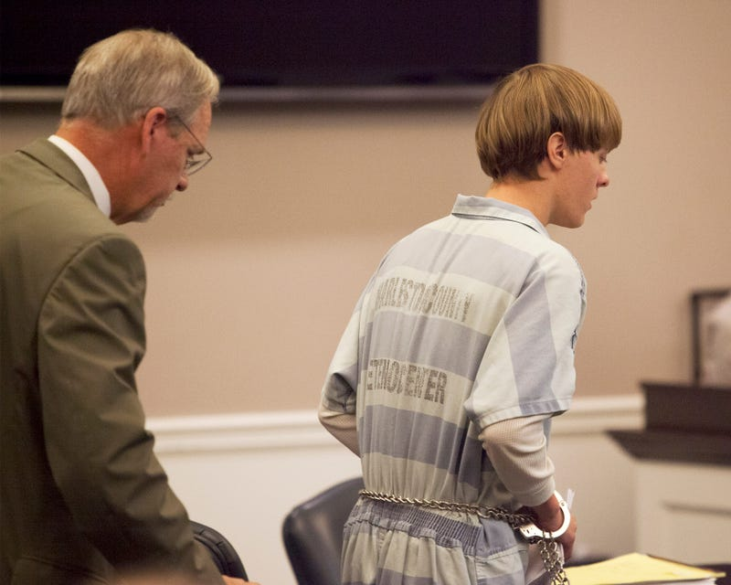 Dylann Roof (right) is helped to his chair by chief public defender Ashley Pennington during a hearing at the Judicial Center July 16, 2015, in Charleston, S.C. Roof is charged with murdering nine worshippers at a historic black church in Charleston.Randall Hill - Pool/Getty Images