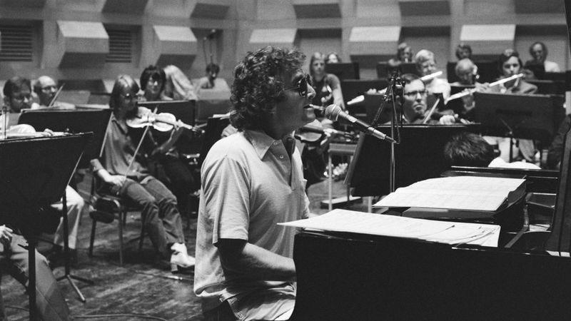 Randy Newman at his piano.