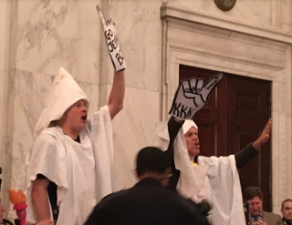 Fake KKK members are arrested during Sen. Jeff Sessions' hearing confirmation for attorney general before the Senate Judiciary Committee on Capitol Hill in Washington, D.C., on Jan. 10, 2017. Twitter