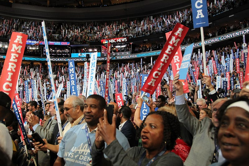 Delegates wave banners on the second day of the 2016 Democratic National Convention at the Wells Fargo Center in Philadelphia on July 26, 2016.  Paul Morigi/WireImage