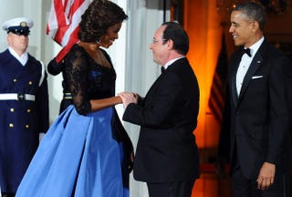 President Barack Obama and first lady Michelle Obama welcome French President François Hollande as he arrives for a state dinner at the White House in Washington, D.C., on Feb. 11, 2014. JEWEL SAMAD/AFP/Getty Images