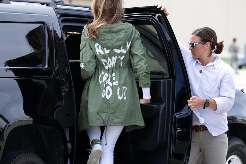First lady Melania Trump climbs back into her motorcade after traveling to Texas to visit facilities that house and care for children taken from their parents at the U.S.-Mexico border June 21, 2018, at Joint Base Andrews, Md.