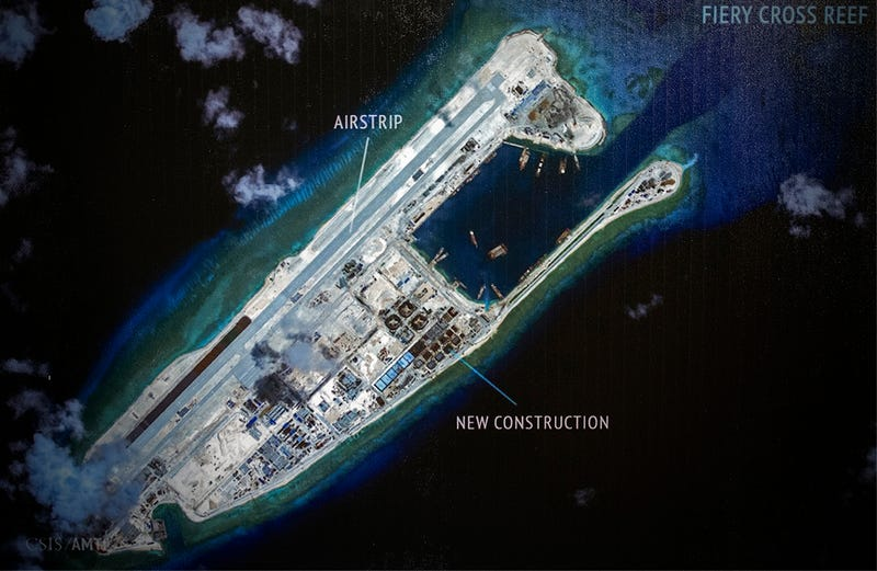 Illustration for article titled China Lands Plane On Growing Man-Made Island Airbase In South China Sea; Now What?