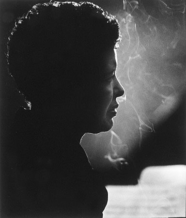 Billie Holiday photographed by Herman Leonard.