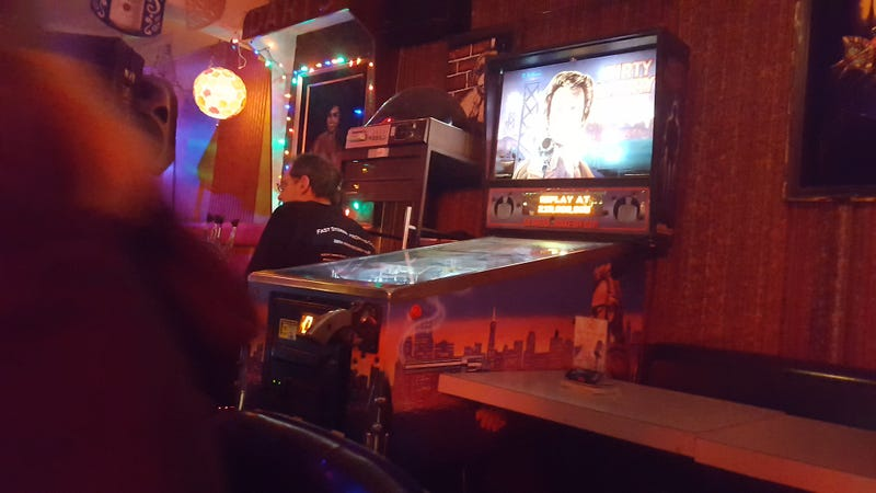 Illustration for article titled This bar has a Dirty Harry pinball machine.
