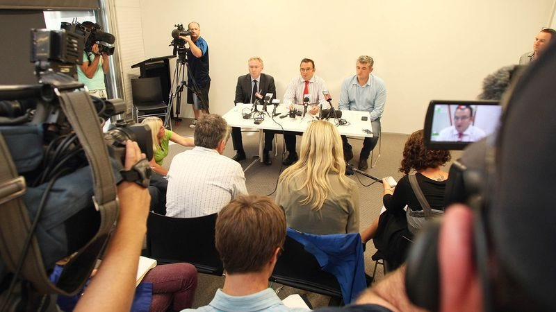 Illustration for article titled Audience At Press Conference Relieved To Hear Steps Will Be Taken