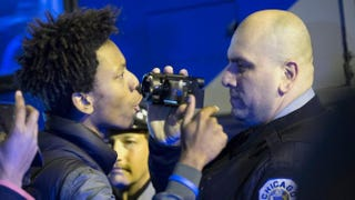 Demonstrators confront police during a protest in Chicago Nov. 24, 2015, following the release of a video showing Chicago Police Officer Jason Van Dyke shooting and killing Laquan McDonald.Scott Olson/Getty Images