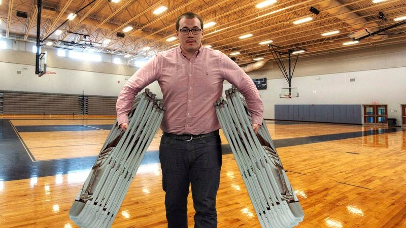 Illustration for article titled Man Hoping People Notice How Many Folding Chairs He's Carrying At Once