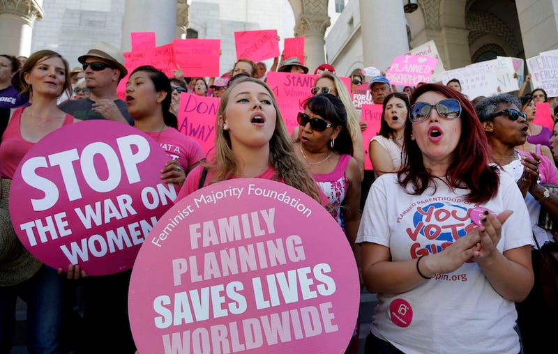 Photo of Planned Parenthood supporters rallying for women's access to reproductive health care via AP