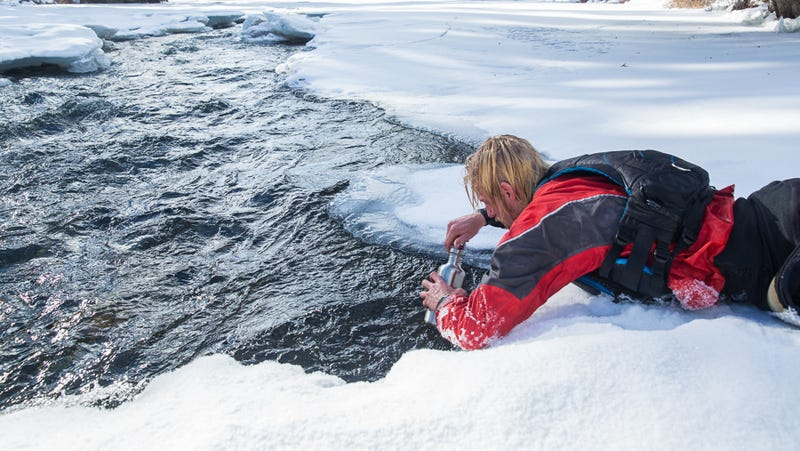 An athlete collects microplastics' samples as part of an Adventure Scientists' project. Image courtesy of Adventure Scientists