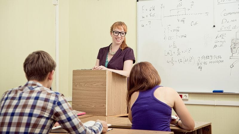 A physics teacher in the classroom.