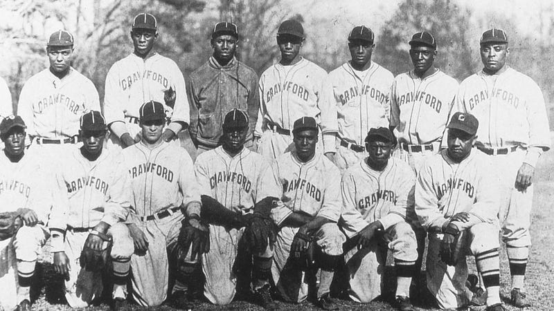 A number of men from the Pittsburgh Crawfords of 1932, including Satchel Paige and Josh Gibson (back row, second and third from left), would play for the Dragones de Ciudad Trujillo.