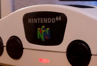 Pictured above: Close-up of an N64 shell that's actually housing a gaming PC. See the full image on Istartedthewar's imgur.