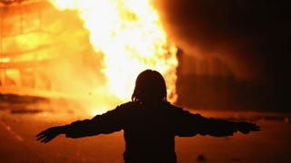 A demonstrator stands as a business burns after it was set on fire during rioting following the grand jury announcement in the Michael Brown case Nov. 24, 2014, in Ferguson, Mo. Scott Olson/Getty Images