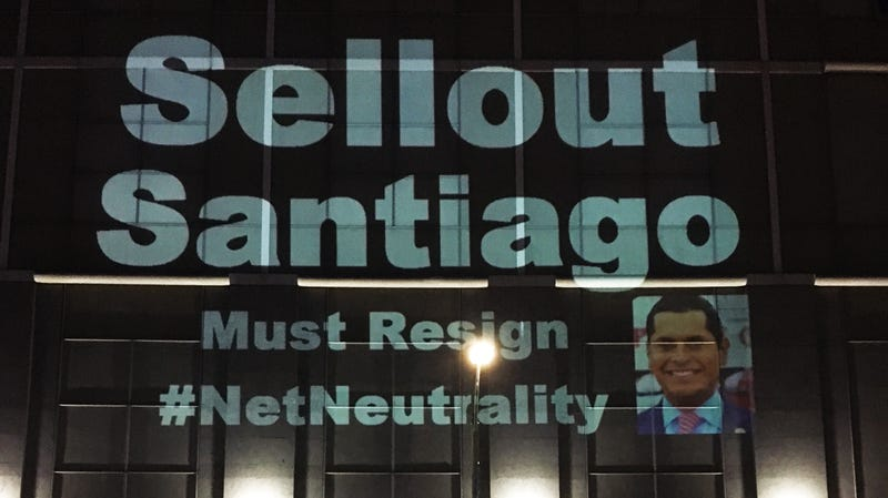 Activists project messages about Assemblyman Miguel Santiago on the AT&T building in Oakland, June 20, 2018