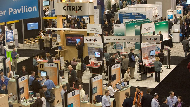 People are seen in the exhibit hall at the RSA conference.
