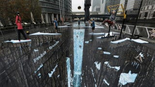 Illustration for article titled The World's Largest 3D Street Art Opens Up a Gateway to Hell