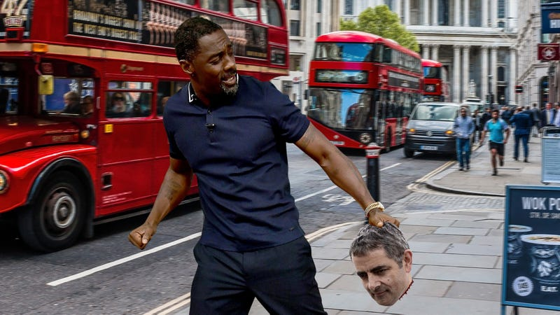 Illustration for article titled Passing The Torch: Idris Elba Is Running Through The Streets Of London Holding Rowan Atkinson's Severed Head, Screaming That He's The Next Mr. Bean