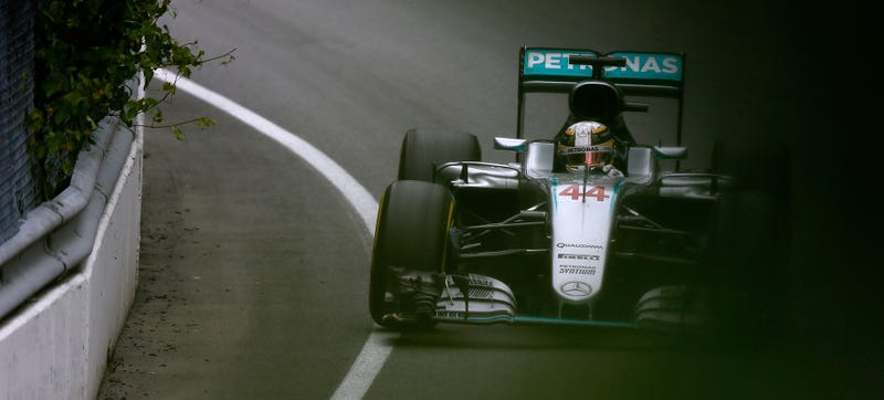 Lewis Hamilton wheeling his Mercedes, the first split-turbo team. Photo Credit: Charles Coates/Getty Images