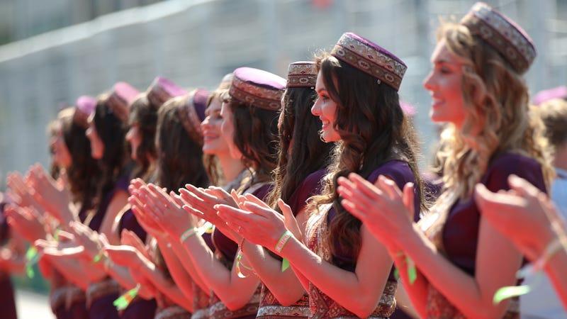 Grid girls applaude drivers prior to the Formula One Grand Prix of Europe at the Baku circuit, in Baku, Azerbaijan, Sunday, June 19, 2016. (AP Photo/Luca Bruno)