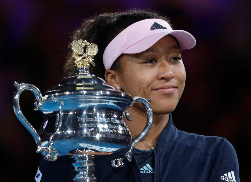 Japan's Naomi Osaka holds her trophy after defeating Petra Kvitova of the Czech Republic during the women's singles final at the Australian Open tennis championships in Melbourne, Australia, Saturday, Jan. 26, 2019.