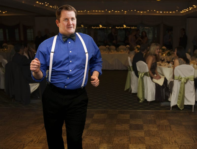 Illustration for article titled Wedding Guest In Suspenders, Bow Tie Unafraid To Take Dance Floor