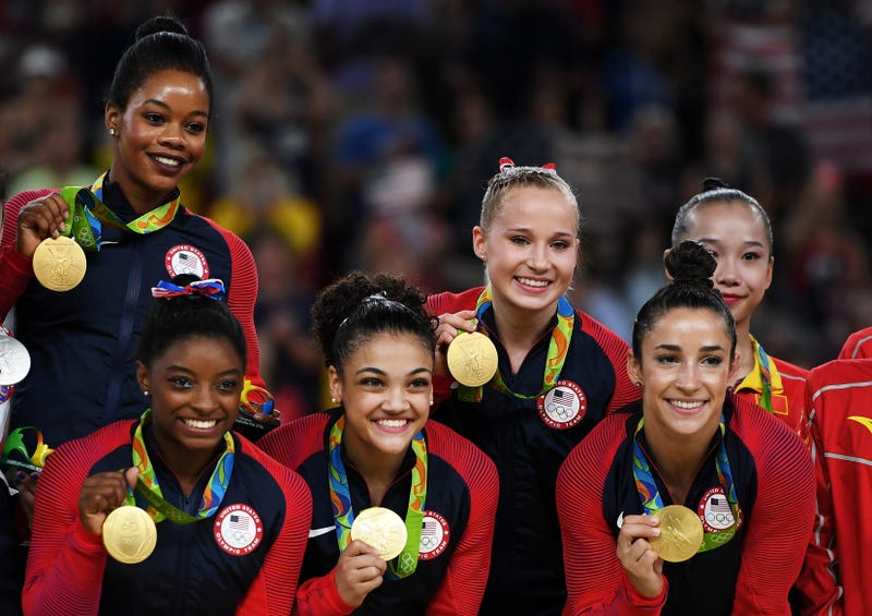 Gold medalists Gabrielle Douglas, Simone Biles, Lauren Hernandez, Madison Kocian and Alexandra Raisman of the United States pose for photographs on the podium at the medal ceremony for the Artistic Gymnastics Women's Team on day 4 of the Rio Olympic Games at the Rio Olympic Arena on Aug. 9, 2016, in Rio de Janeiro. Laurence Griffiths/Getty Images