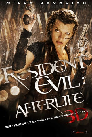 Illustration for article titled Milla Jovovich, Wet, With Guns