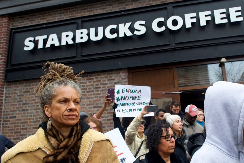 Protester Michelle Brown demonstrates outside a Center City Starbucks in Philadelphia on April 15, 2018, in the wake of the arrest of two black men who were waiting inside the Starbucks, prompting an apology from the company's CEO.