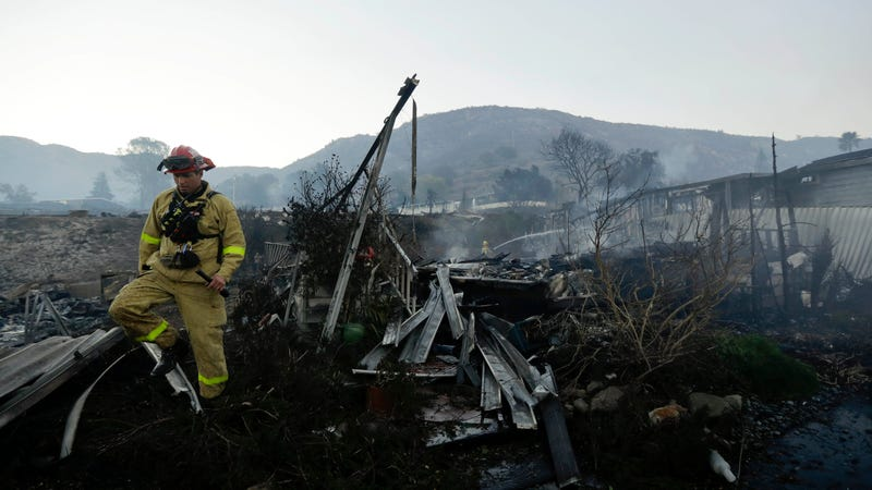 Fire crews search for hot spots among destroyed homes in the Rancho  Monserate Country Club community Friday, Dec. 8, 2017, in Fallbrook,  Calif. Image: AP Photo/Gregory Bull