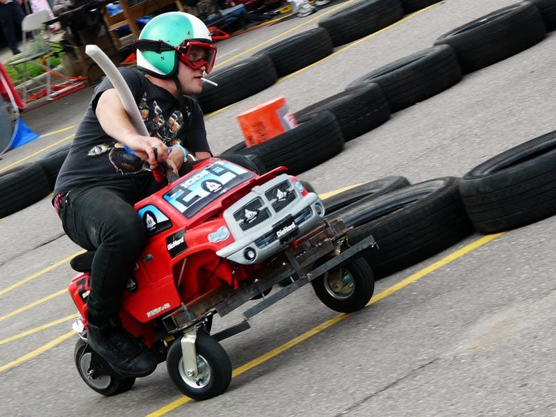 Hacked Racing Toys : Power wheels racing fat men on souped up toy cars