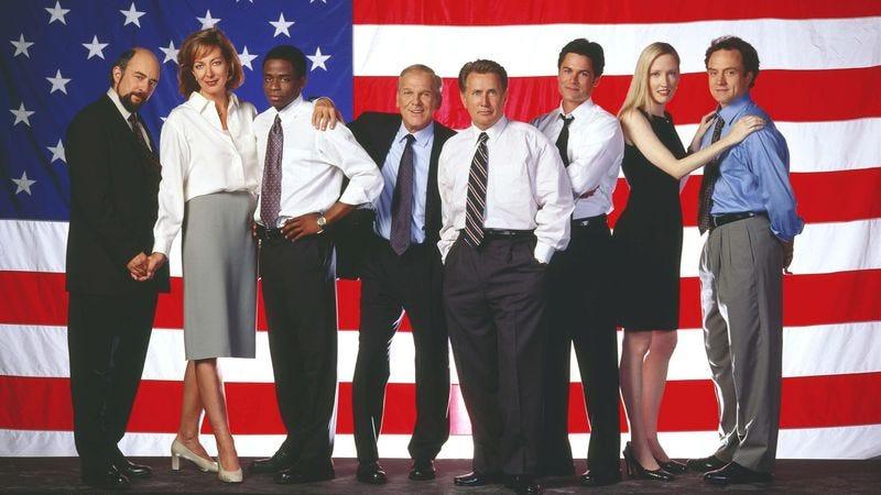 The cast of The West Wing. Richard Schiff (left), Allison Janney, Dulé Hill, John Spencer, Martin Sheen, Rob Lowe, Janel Moloney, Bradley Whitford