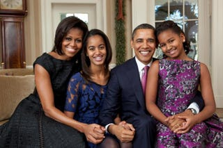 First lady Michelle Obama, Malia Obama, President Barack Obama and Sasha Obama sit for a family portrait in the Oval Office on Dec. 11, 2011, in Washington, D.C.Pete Souza/White House via Getty Images