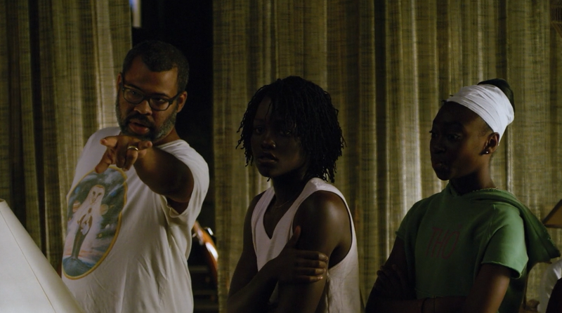 Jordan Peele directs Lupita Nyong'o and Shahadi Wright Joseph in a scene from Us.