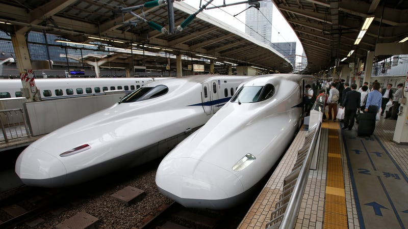 In this Sept. 24, 2014 filephoto, passengers get on the Shinkansen high-speed train at Tokyo station in Tokyo