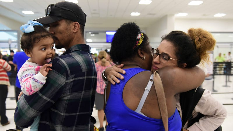 Waritza Alejandro embraces her mother-in-law before boarding a flight to Tampa with her husband and daughter in Puerto Rico November 8, 2017. Photo: AP