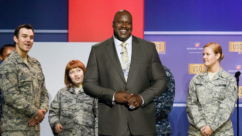 Shaq performing for the troops.