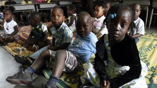 Children stand in a nursery while their parents are away at church on Sept. 28, 2014, in Monrovia, Liberia. The hardest-hit nation, Liberia has seen 3,000 cases of Ebola and almost 1,600 deaths, with health workers turning people away from treatment units because of chronic shortages of beds and staff.PASCAL GUYOT/Getty Images