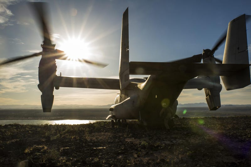 Illustration for article titled Peaceful shot of a MV-22 Osprey overlooking the Sun on top a mountain