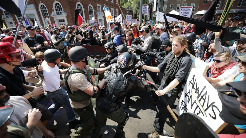 White nationalists, neo-Nazis and members of the 'alt-right' clash with counter-protesters as they enter Emancipation Park during the 'Unite the Right' rally August 12, 2017 in Charlottesville, Virginia. Image via Getty.