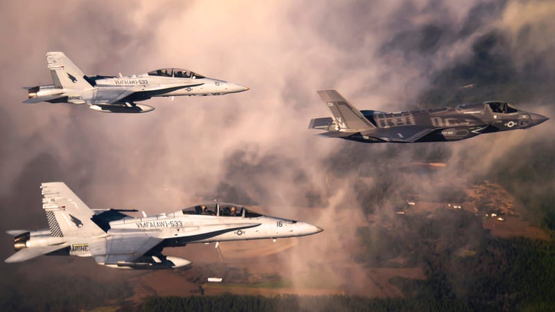 Two F/A-18 jets fly behind an F-35B. Photo credit: U.S. Marine Corps