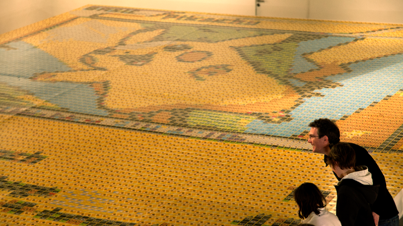 Illustration for article titled UK Artist Makes Enormous Pikachu Mosaic Out of 12,987 Pokémon Cards