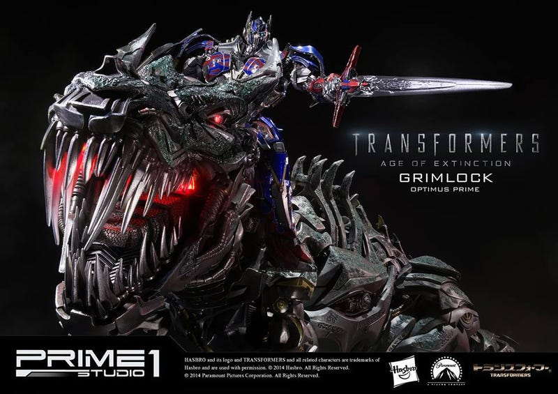 Illustration for article titled Glorious Grimlock and Optimus Prime Statue