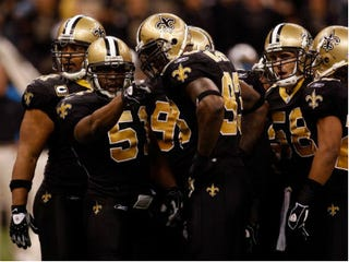 Jonathan Vilma (51) huddles with teammates. (Chris Graythen/Getty Images)