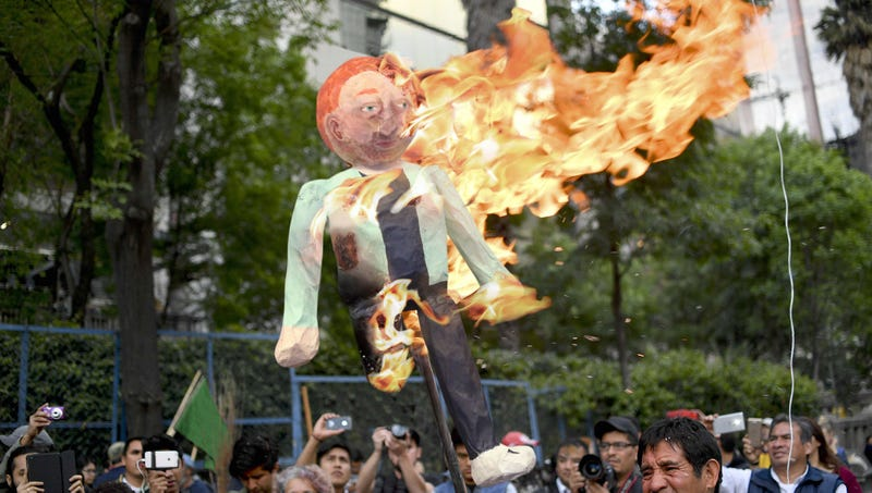 Illustration for article titled Thousands Of Onion Social Users Burn Effigies Of CEO In Massive Show Of Support For Company