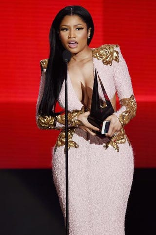 "Nicki Minaj accepts the favorite rap/hip-hop album award for ""The Pinkprint"" during the 2015 American Music Awards in Los Angeles Nov. 22, 2015.Kevin Winter/Getty Images"